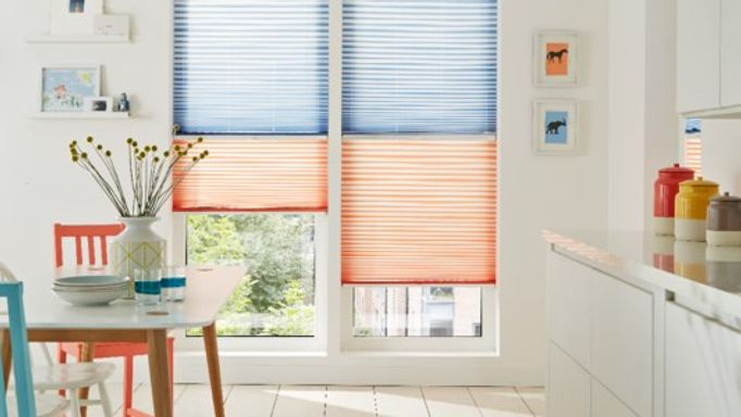 Day and night transition pleated blinds in a kitchen window to control light