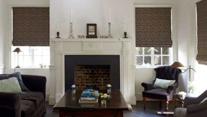 Brown Roman blinds in a living room