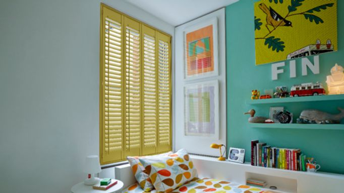 Yellow Wooden shutters in Guest bedroom