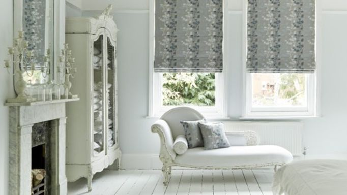 silver roman blind in white room