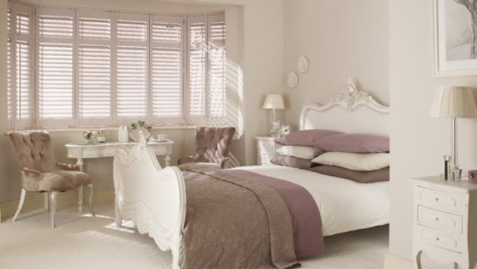 Window Shutters in a French themed bedroom
