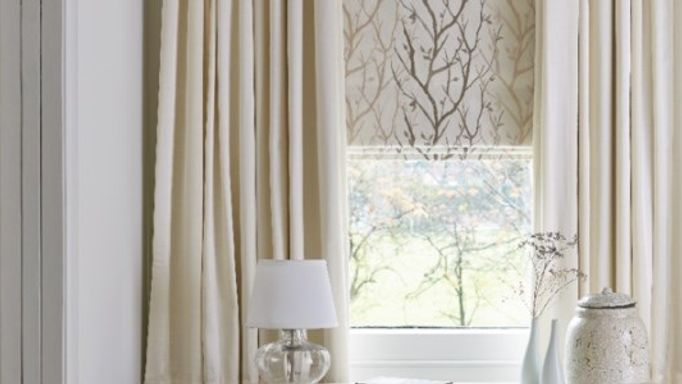 Cream curtains and roman blinds living room