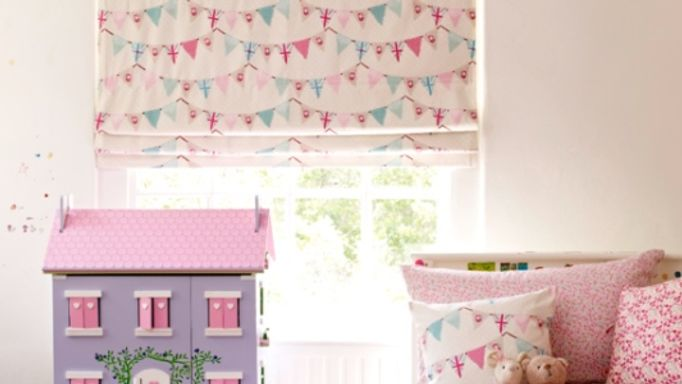 Pink Bunting Patterned Roman blind in children's bedroom