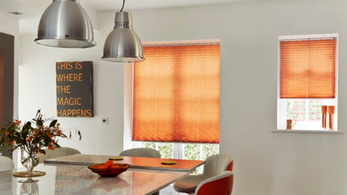 Orange Pleated blinds in kitchen