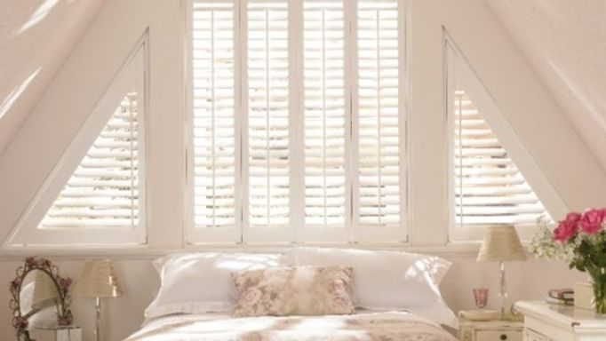Shaped wooden shutters for unusual blinds bedroom
