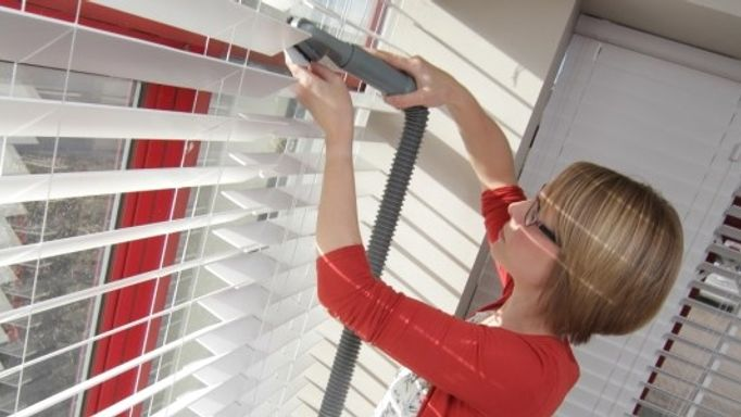 Clean wooden blinds with a vacuum cleaner