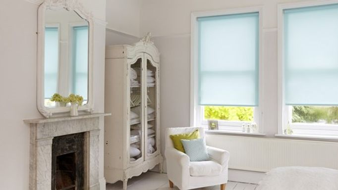 Lisbon aqua blue roller blind in bedroom