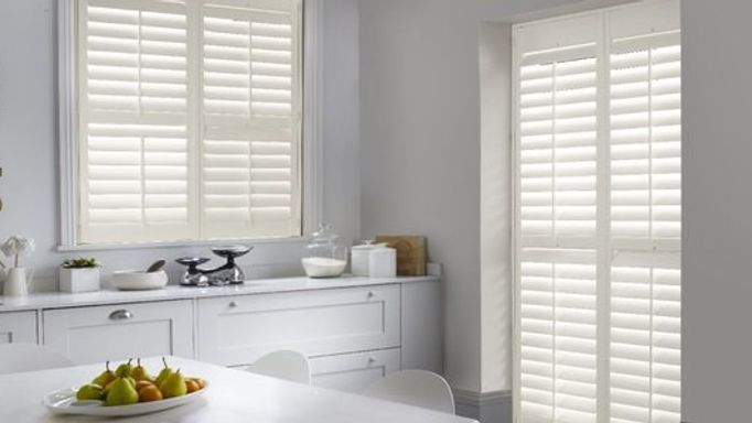 white henley shutters in white room