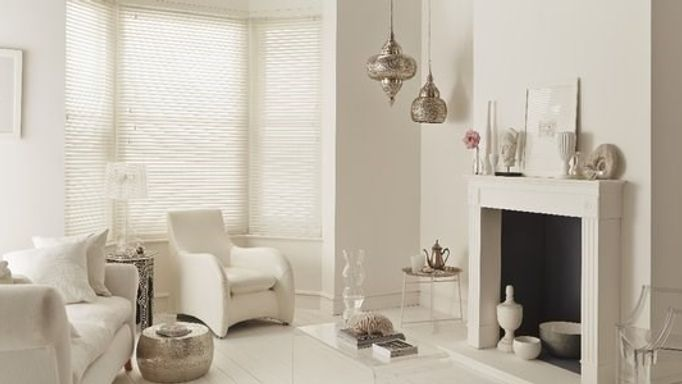 white wooden blinds in white living room