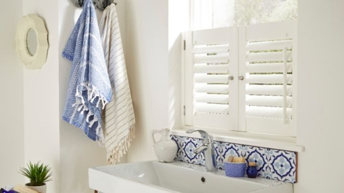 White shutters in bathroom