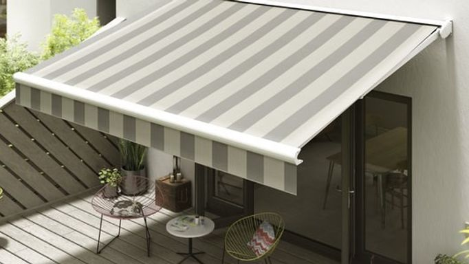 white and grey striped awning on a contemporary patio area