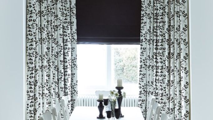 white and black curtains with a black roman blind in the dining room