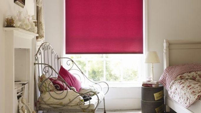 acacia raspberry roller blind in bedroom