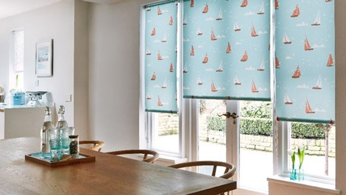 Teal blind with boat pattern in kitchen
