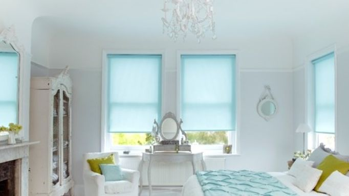 Lisbon Aqua blue roller blind in the bedroom