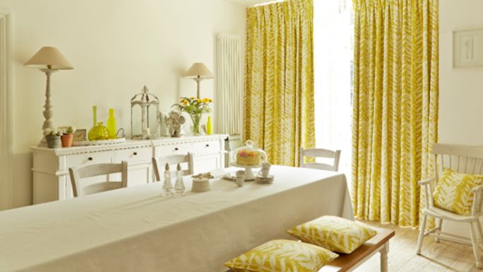 Yellow curtains in a dining room window