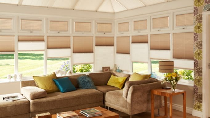 Brown Day and Night Transition Blinds in a conservatory