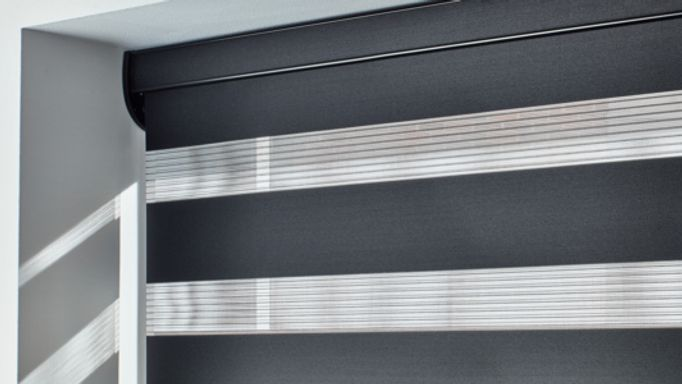 Black Enlight Roller Blind in the Conservatory - Cascade Jet Enlight Roller blind