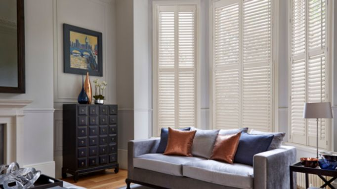 Wooden shutters in bay window