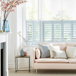 Blue cafe style shutters in the living room - Cloud Blue