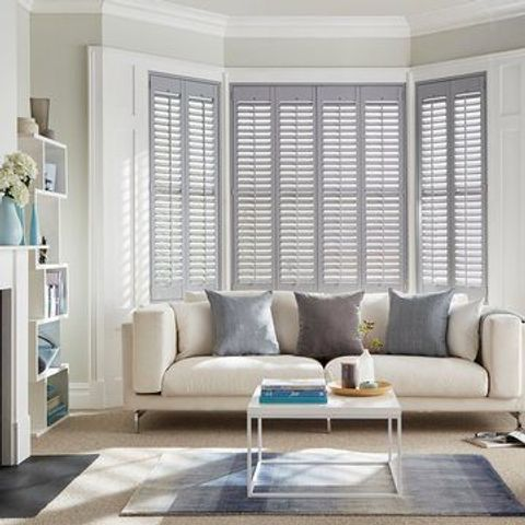 Grey full height shutters in the living room
