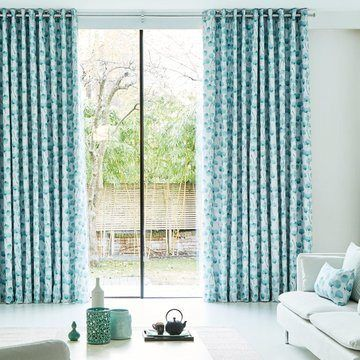 Blue patterned eyelet curtains in the living room - Honesty Mist Eyelet Curtains