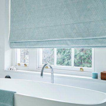 Origami Mist Blue Roman Blind in Bathroom