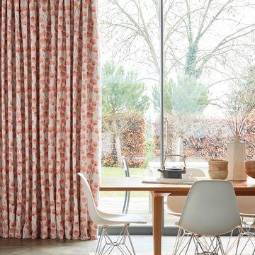 Coral patterned made to measure curtains in the dining room - Origami Persimmon curtains fabric