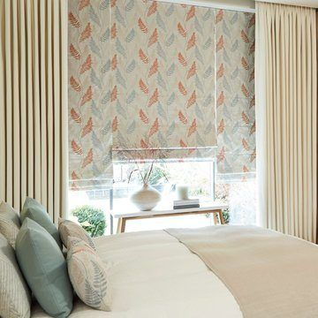 Tetbury Ivory Curtains with Tranquility Dawn Roman Blinds in the bedroom