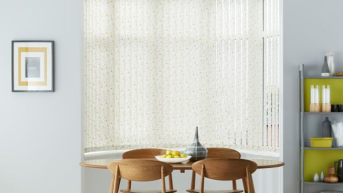 Edre-Gold-Vertical-blind-in-a-curved-bay-window