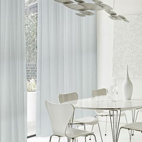 White made to measure voile curtains in a dining room window - Astro White voile curtain