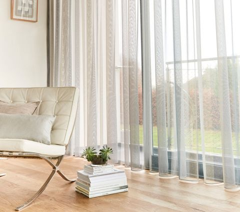 Ombre Smoke Light Grey Voile Curtains in a Living Room