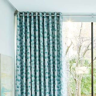 teal curtains - living room - honesty mist