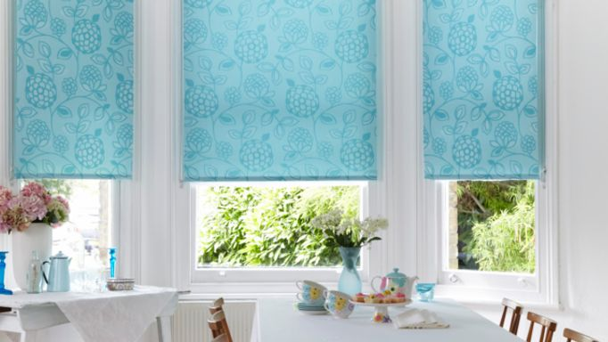 Serena-Teal-Roller-blind-in-bay-window
