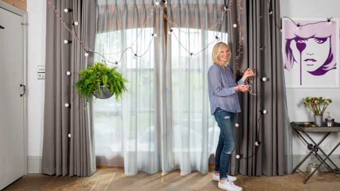 Jo-Whiley-collaboration-indoor-cameo-putting up fairy lights