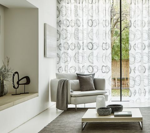 Swirl Dusk Sheer Voile Curtains in Living Room Window with armchair