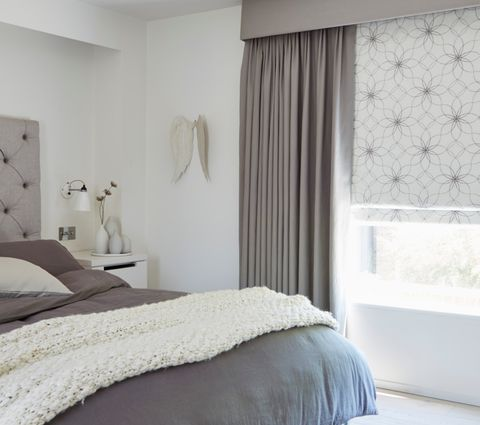 Bedroom with White Pattern Lavida Smoke Roman Blind and Grey Tetbury Charcoal Curtains