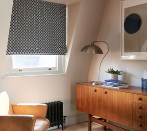 Eclipse Denim Patterned Roman Blind in Home Office with lamp and armchair