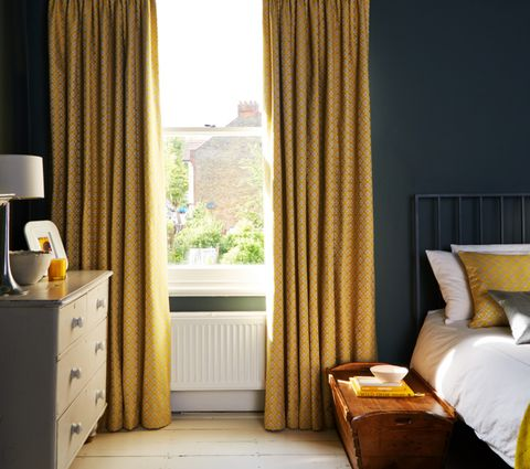 Eclipse Mimosa Yellow Curtains in a Bedroom