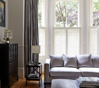 Pure White cafe-style Shutters with Erika Charcoal Curtains