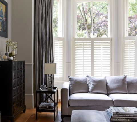 Living Room Window with Pure White Cafe Style Shutters paired with Erika Charcoal Curtains
