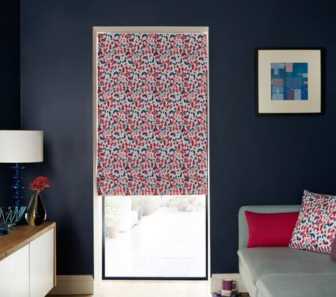 Living Room with Blossom Raspberry Multi Colour Print Roman Blind with Pink and Blue