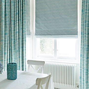 Blue-riviera-turquoise-curtains-and-daze-peacock-roman-blind-dining-room
