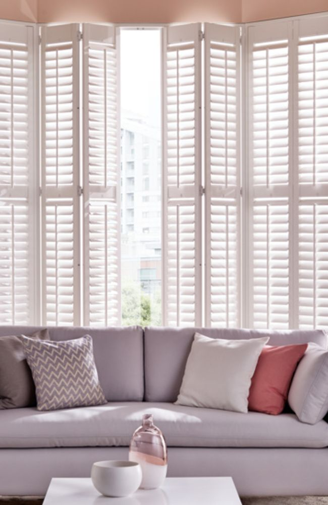 white-shutters-living-room-bay-window