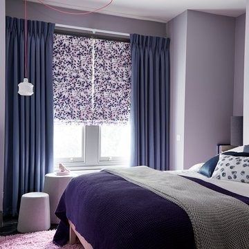 blue triple pinch pleat curtains in the bedroom with a roman blind - iris shadow made to measure triple pinch pleat curtains