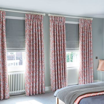 floral pinch pleat curtains in bedroom - Blossom Persimmon Pinch Pleat Curtains and Clarence Platinum Roman Blinds