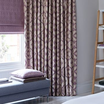 Purple patterned curtains in the bedroom - Mindora thistle