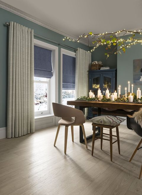 Festive Dining Room with Malva Duck Egg Eyelet Curtains layered over Islita Blue Roman Blinds