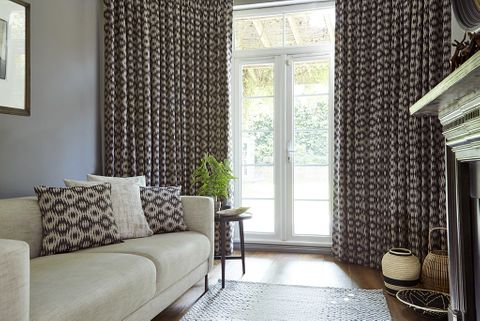 Living Room with Black Pattern Curtains in Muriva Cocoa Fabric and matching cushions