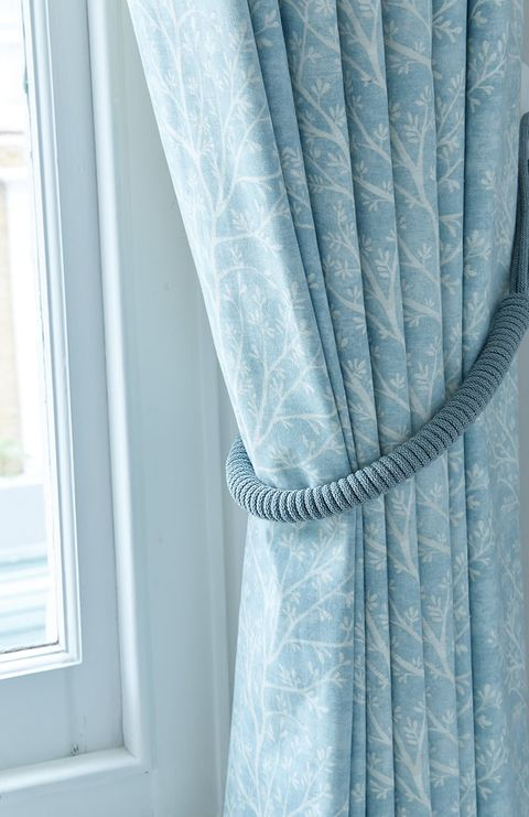 Close up of blue curtains in a floral print